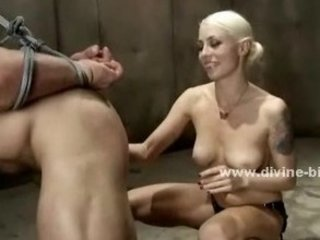 Busty blonde mistress spanking man slave while riding another bei
