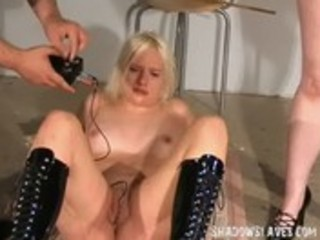 Two slaves mutual electro torture and whipping in a sadistic gameshow for crying