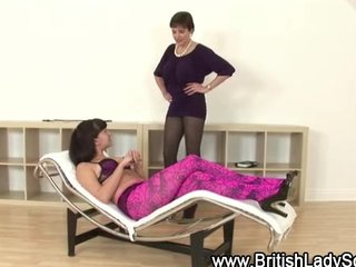 Couple of mistresses get to whipping each other in lingerie
