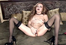 she starts out clad in nothing but black stockings, a naughty look in her eye. well, she soon loses her only items of clothing, whips out a sex toy, and goes to town. i knew it!
