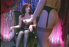dark brown doxy spanks the golden-haired hotties butt