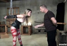 Blonde is chained and spanked by dominant mas