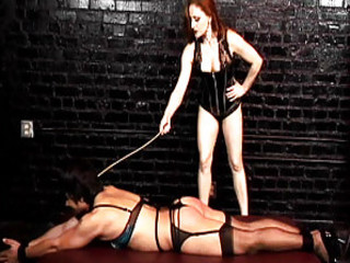 Hot Red Headed Dominatrix Spanks Her Man
