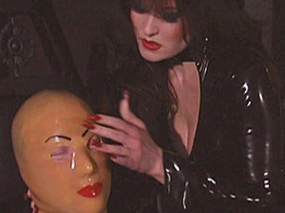 Kinky Dominatrix Spanks Her Slave
