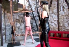 Leather Domina administers heavy flogging