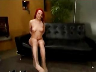 Redhaired girl whipped licking mistress boots and pussy while spanked with stick on the couch