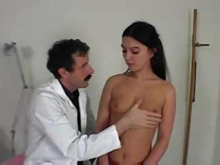 Brunette Muriel is with the doctor who spanks her and checks pussy