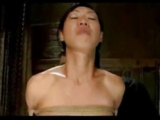 Asian girl bondaged balancing while whipped fingered by mast