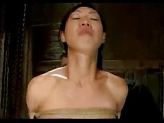 Asian girl bondaged balancing while whipped fingered by mast