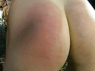 Crying slave with big tits is spanked on her ass by her mast