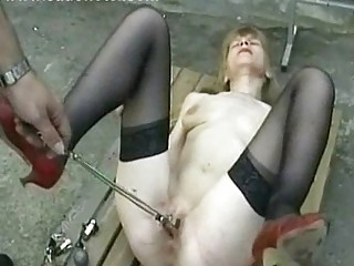 Hot and horny slave is spanked on her ass and pussy by maste