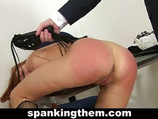 Redhead babe spanked by teacher