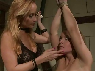 Classy mistress punishing young girl