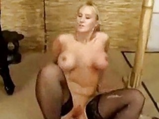Blonde girl getting plug to her butt whipped by mistress fin