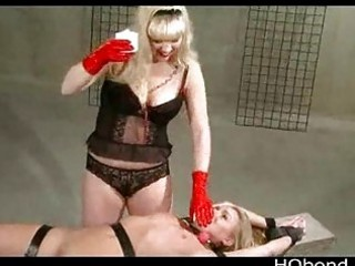 Strapped on wooden device gal gets waxed and whipped