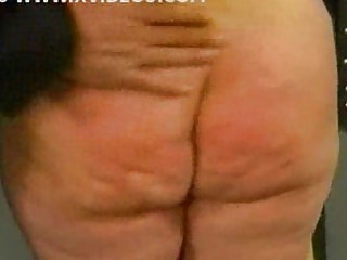 Chubby slave is spanked on her ass and plays with her pussy