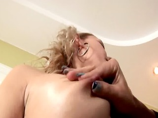 dominant brunette spanking a cute blondes firm butt