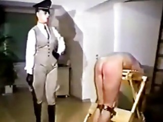 A dominant woman spanks tied up mans ass