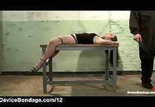 locked to table brunette gets flogged by master