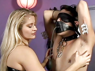 sexy corseted dom punishes tattooed slave.