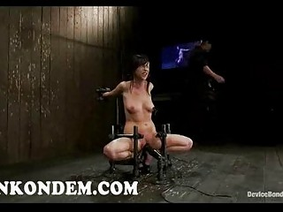 Bound brunette toyed and flogged