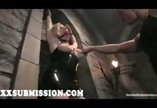 Bound blonde gets tits slapped