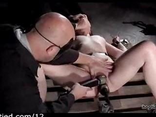 Bound babe flogged and toyed by masters
