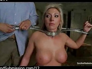 Restrained busty blonde flogged