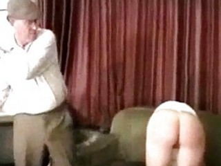 Girl in white lingerie whipped spanked with stick by master