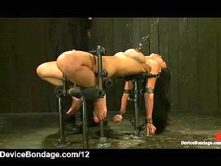 bound in metal device babe flogged