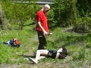 Skinhead punishing thief by wagons