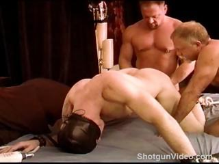 2 tops place a young hot muscular beginners ball sack in a clamp and then punish his balls.