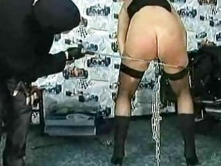 Masked master spanks milf slave with big tits and metal clam