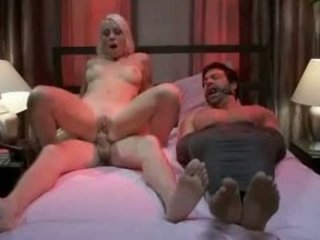 Busty blonde rides man while spanking other tied one in woman dom