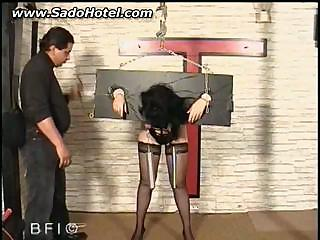 Hot slave stuck in scaffold gets spanked by master