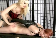 Ginger femdom makes her blonde sub suffer with hot wax