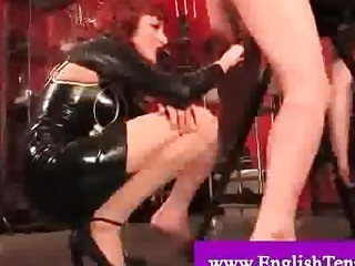 Dominatrix whipping and spanking servant