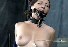 Masked beauty with exposed cunt receives flogging