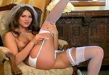 beautiful aspen rae looks like a bride and that is what she is thinking about while flogging her clitoris on a chair. you will love her long legs in white sexy stockings.