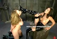 brunette slaps and floggs her slave