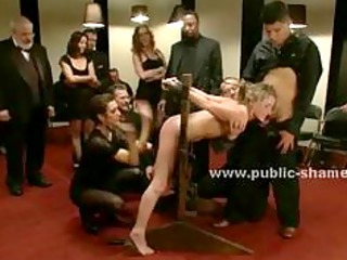 sex slave is bound tight in middle of public room and made to f
