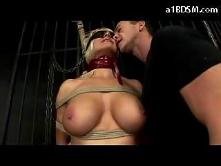 Busty Blindfolded Blonde Bondaged Getting Her Pussy Fingered Tits Rubbed Whipped In The Dungeon