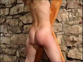 Redhead is tied up and bound so her master can whip her ass