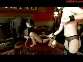 Asian slave getting her pussy stimulated with vibrator whipped by master pussy licked by other slave in the lounge in front of other people