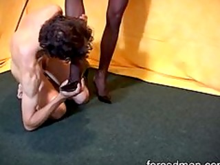 slave is demanded to lick and massage mistress tired legs