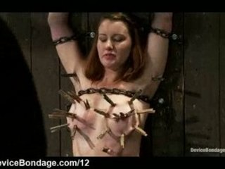 Chained clamped babe flogged and pussy vibrated