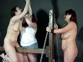 wooden horse bondage and palm spanking of two cane
