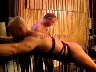 Caning my hot bodybuilderbuddys muscle butt while restrained,