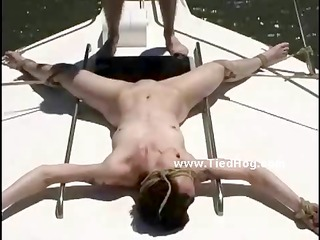 babe held prisoner on a boat naked and tied with hands and legs behind in uncanny position