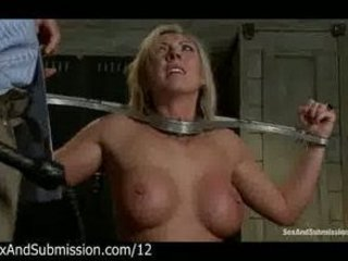 Restrained busty blonde gives blowjob and flogged